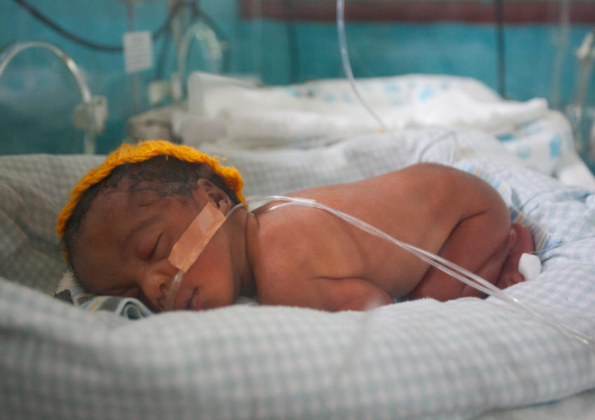 Nakintu Prossy's two-day-old preterm baby girl sleeps in an incubator in the Neonatal Intensive Care Unit (NICU) at Kiwoko Hospital on August 30, 2012 at the facility in Kiwoko, Nakaseke district, Central Uganda. Nakintu gave birth to twins, one boy and one girl six weeks early. The baby boy was was receiving kangaroo mother care from his mother at the time of this photograph. Nakintu heard about kangaroo mother care during her antenatal care sessions and said she will be an advocate for KMC with her family and friends. She knows that it will provide her babies with normal brain growth and will allow for bonding between her babies and her.